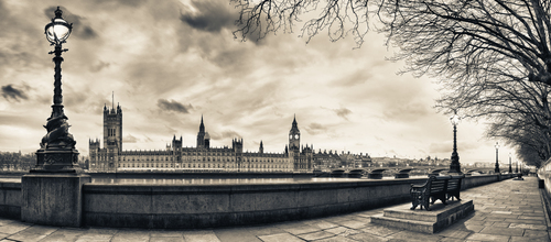 Panoramic view of Houses of Parliament at dusk from the River Thames in London,England