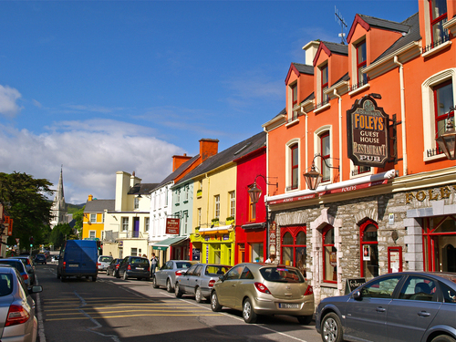 The colourful high street in Kenmare in afternoon spring sunshine, County kerry.