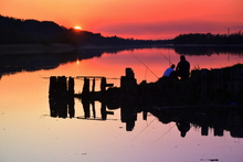 Some local fishermen fishing the full tide at Fiddown on the River Suir.
