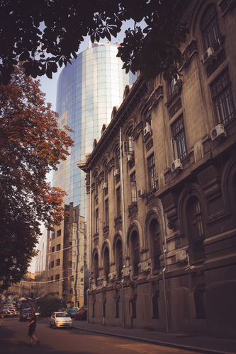 An office tower next to an old building on Lipscani Street in Bucharest.