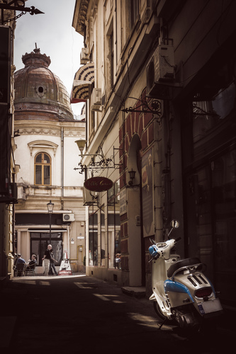 Motor-scooter parked on Nicolae Selari Alley in the Old City of Bucharest.