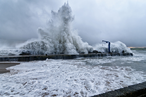 storm waves crashing over Bunagee pier Culdaff Co Donegal Ireland