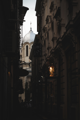 View along a narrow alley in the Old City in Bucharest
