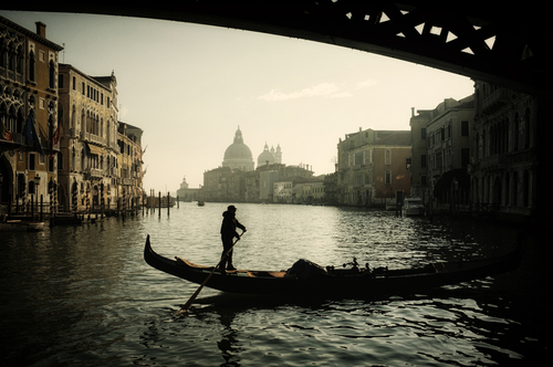 The view from beneath the Accademia Bridge which straddles the Grand Canal, Venice, Italy.