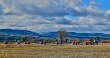 A collection of tractors from the Mooncoin Ploughing Championships held in Portnascully, Mooncoin, County Kilkenny on Saturday March 5th 2016. What a lovely landscape with a view of Portlaw and Curraghmore in County Waterford, across the river Suir, which runs between both counties.