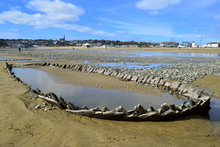 The remains of an old wooden ship can presently be seen on the beach in Tramore, County Waterford, Ireland as the sand is very low. Two more smaller boat wrecks are also visible,but not the full hull.