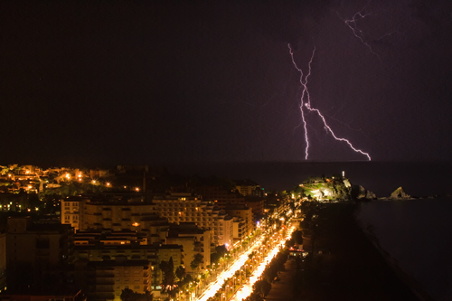 A lightning storm over the Mediterranean Sea with Almuñécar in the foreground
