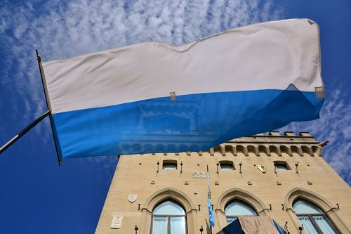 The Republic of San Marino's flag and the Government Palace.