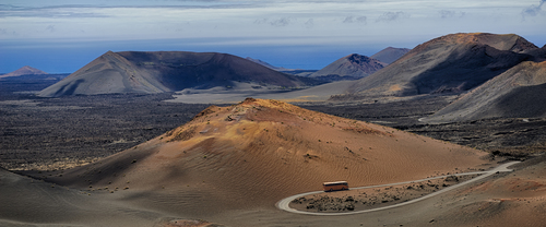 Lanzarote; Canary Islands; Timanfaya; volcano; crater; landscape; lava; field; mountains; volcanic; rock; road; nature; scenics; Spain; Africa; arid; desert; travel; destinations; landmark; geographic; panoramic; panorama; touristism; tourist attraction; bus; coach; tour; sightseeing