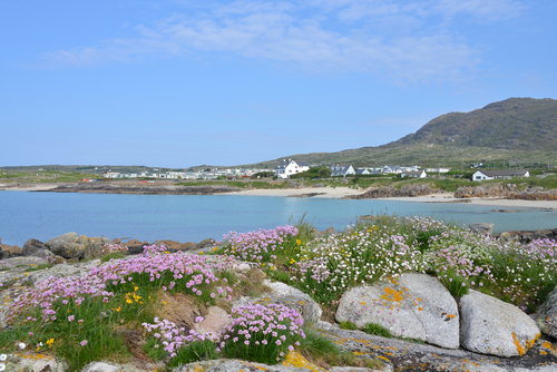 A view from the rocky shoreline back to the beautiful beach at Gurteen Bay near Roundstone, Co. Galway