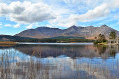 A panoramic shoreline view of the boathouse at Lough Inagh, Connemara.