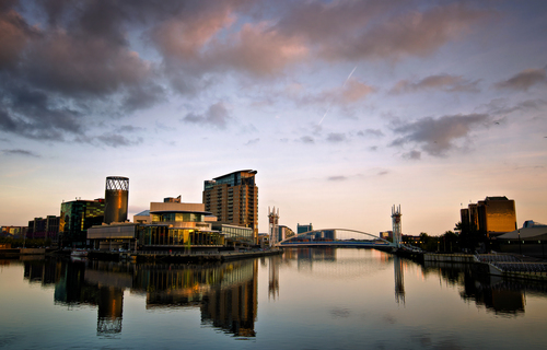 The Lowry Theatre and Lift Bridge at sunset.. Salford Quays, Manchester