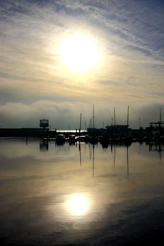 Early morning sunlight reflections across the harbour at Carrickfergus outside Belfast