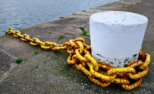 A mooring chain on Howth's East Pier lies idle while the trawler is out fishing.