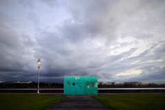 An Art Deco shelter faces the early evening storm clouds gathering over Dublin Bay.