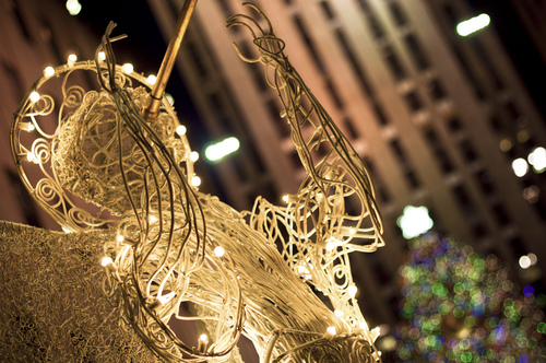 The chorus of wicker angels form an honor usher crowds of visitors towards the Rockefeller Plaza Christmas Tree.