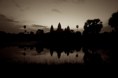 The Sun Rises behind these this recently discovered city in Siam Reap, Cambodia.