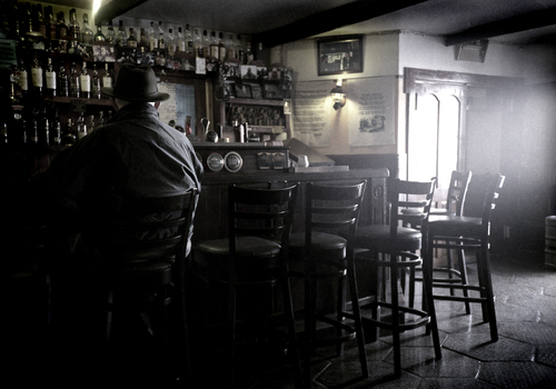 Old man has his first pint of the day at a quiet pub in Cong, Co Mayo.