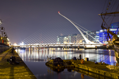 View of the Samuell Beckett Bridge and Jeanie Johnston from the North Side of the Liffey looking out in the direction of the docklands. 