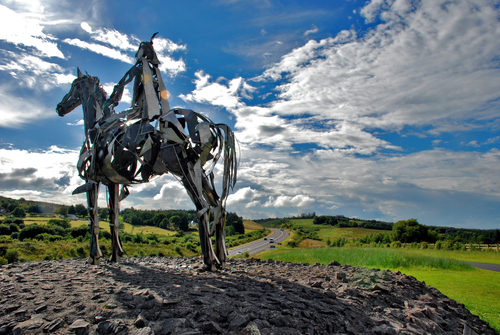 Two miles north of the town of Boyle, is the site of the Battle of the Curleius, which took place in 1599. It is commemorated by one of Ireland's most magnificent road-side pieces of sculptured metal of a Gaelic Chieftain, sculptured by Maurice Harron.