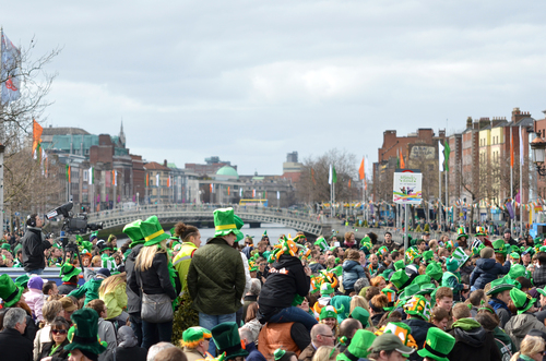 View towards the Ha'Penny bridge in Dublin on St. Patrick's day.