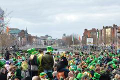 View towards the Ha'Penny bridge in Dublin on St. Patrick's day.