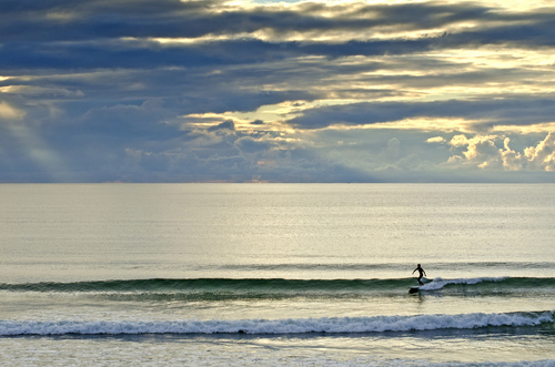 Surfing scene in the late evening in Strand Hill, Sligo