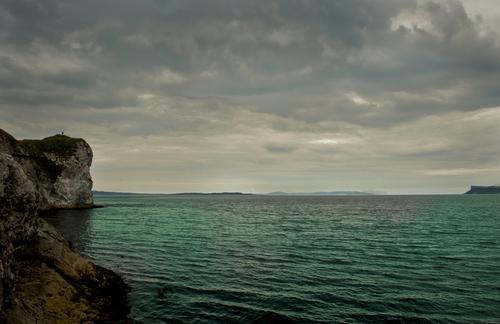 Looking toward the Mull of Kyntre on teh Scottish Coast, from Kinbane Head, on the Antrim coast near Ballycastle